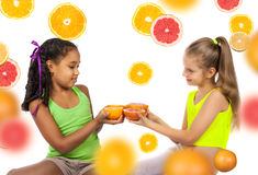 Joyful girl with citrus Stock Images