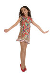 Joyful girl in colorful dress jumps Royalty Free Stock Photography