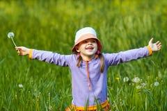 Joyful girl with dandelion Stock Photo