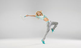 Joyful girl exercising with paint roller Stock Images