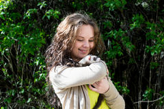 Joyful girl with ferret in the hands royalty free stock photos
