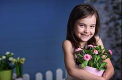 Joyful girl with flowers Stock Photography