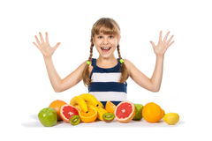 Joyful girl with fruit Stock Photos