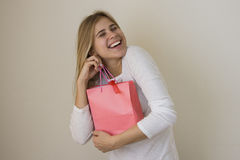 Joyful girl gets her sale bag present Stock Photography