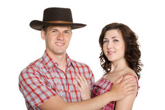 Joyful girl and a guy in a stetson. Isolated on white Royalty Free Stock Images