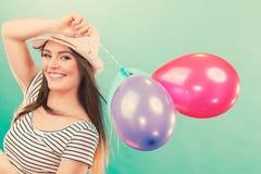 Joyful girl have fun with colorful balloons. Stock Image