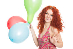 Joyful girl holding colorful balloons Royalty Free Stock Image