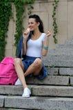 Joyful girl holding an ice cream in her hand. Royalty Free Stock Photography