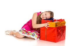 Joyful girl hugs box gift Stock Photography