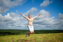 Joyful girl in a jump Royalty Free Stock Photo