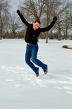 Joyful Girl Jumping in Winter Stock Image