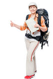 Joyful girl with map travel alone with a backpacker Royalty Free Stock Image