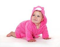 Joyful girl in pink dressing gown. Stock Photo