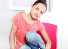 Joyful girl in a pink T-shirt Royalty Free Stock Photos