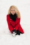 Joyful girl playing with snow royalty free stock image