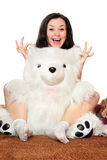 Joyful girl plays with a teddy bear Stock Photography