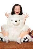 Joyful girl plays with a teddy bear Stock Photography