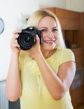 Joyful girl with professional photocamera Royalty Free Stock Image