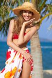 Joyful girl in red bikini posing at the beach Royalty Free Stock Photography