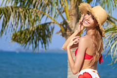 Joyful girl in red bikini posing at the beach Stock Image