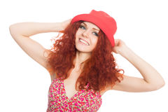Joyful girl in a red hat isolated on white. Stock Photography