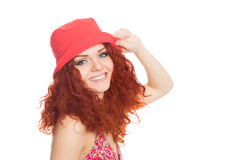 Joyful girl in a red hat isolated on white Royalty Free Stock Photography