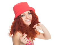 Joyful girl in a red hat pointing at the camera Stock Image