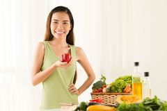 Joyful girl with red pepper Stock Images