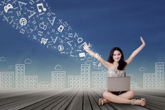 Joyful girl sharing message with laptop Stock Photography