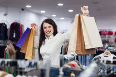 Joyful girl with shopping bags. Portrait of joyful girl with shopping bags Stock Photography