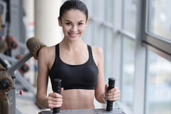 Joyful girl spending time in a gym Royalty Free Stock Photos