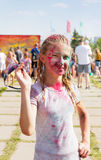 Joyful girl sprinkled with dry paint Royalty Free Stock Photo