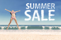 Joyful girl with summer sale cloud Royalty Free Stock Image