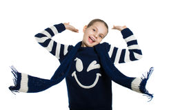 Joyful girl in sweater and scarf posing in the studio. Scarf flying in the wind. Stock Images