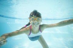 Joyful girl swimming underwater Royalty Free Stock Images