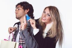 Joyful girl takes boyfriend credit card Royalty Free Stock Images