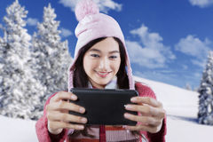 Joyful girl taking self picture with cellphone Royalty Free Stock Photo