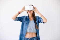 Joyful girl using VR device Royalty Free Stock Image