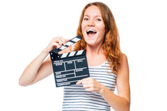 Joyful girl on a white background with a movie clapper Royalty Free Stock Photos