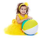 Joyful girl in a yellow dress Stock Images