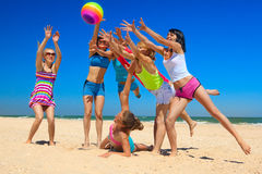 Joyful girls playing volleyball Stock Images