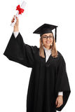 Joyful graduate student holding a diploma in the air. Isolated on white background Royalty Free Stock Photos