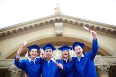 Joyful graduates Stock Photography