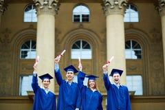 Joyful graduates Stock Images