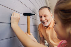 Joyful grandfather teaching future generation his housework Royalty Free Stock Photo
