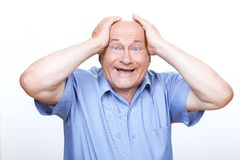 Joyful grandfather touching his head Royalty Free Stock Photos