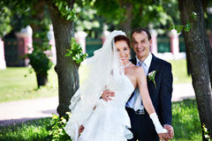 Joyful groom and bride in park Stock Image