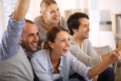 Joyful group of friends watching football game Royalty Free Stock Image