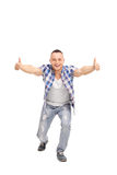 Joyful guy with an attitude, giving thumbs up Stock Photos