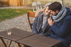 Joyful guy and girl hugging outdoors Stock Photos